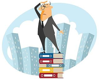 Cartoon_man_in_suit_on_stack_of_books_searching_for_apartment_.jpg