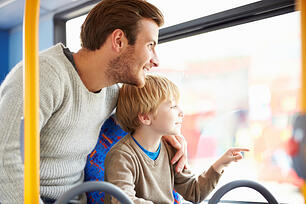 father and son riding the bus