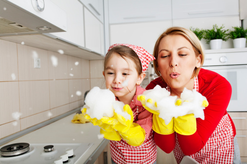 woman and girl blowing soap bubbles