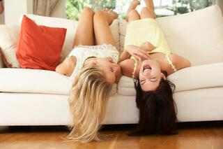 roommates laughing on the couch