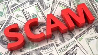 Scam on a pile of hundred dollar bills
