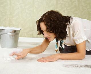 Women_cleaning_carpet_while_on_hands_and_knees