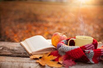 book and mug in a fall setting