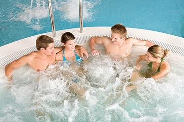 people sitting in jacuzzi