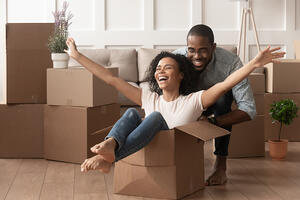 couple playing in moving boxes