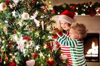 kids decorating a christmas tree-608640648.jpg