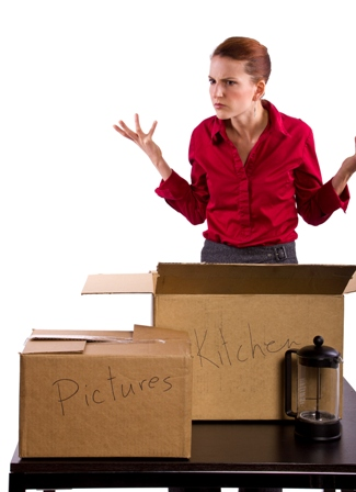 woman with moving boxes looking stressed